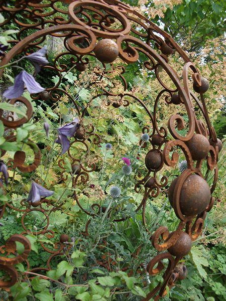 Iron spheres in cottage garden